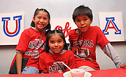 Joan June, 7, (left), Megan June, 8, and Taja June, 10, pose for photographs while attending a luncheon with their father, Keith June of Tucson, at the NASA Wildcat Family Pride Weekend. June is a linguistics major at the University of Arizona, Tucson, Arizona, USA.