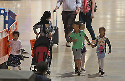 **MINIMUM FEE FOR USE - see  special instructions** © licensed to London News Pictures. London, UK. A woman walks through Paddington Station with a group of young children who have been used for begging.. Organised groups of beggars use woman and young children to beg around shopping areas of west London. The groups use minors to approach men and woman leaving high end shops, asking for money . The children are well trained, targeting only wealthy looking people with middle eastern appearance. The women supervise the children from a few steps away. Photo credit: J.A/LNP