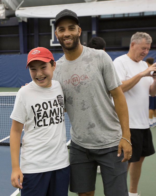 August 21, 2014, New Haven, CT:<br /> James Blake poses for a photograph during a pro-am session during the Men's Legends Event on day seven of the 2014 Connecticut Open at the Yale University Tennis Center in New Haven, Connecticut Thursday, August 21, 2014.<br /> (Photo by Billie Weiss/Connecticut Open)