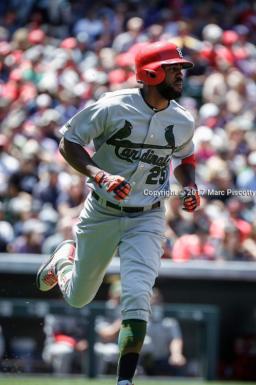 SHOT 5/28/17 12:47:32 PM - The St. Louis Cardinals Dexter Fowler #25 runs the bases during their regular season MLB game against the Colorado Rockies at Coors Field in Denver, Co. The Rockies won the game 8-4. (Photo by Marc Piscotty / © 2017)