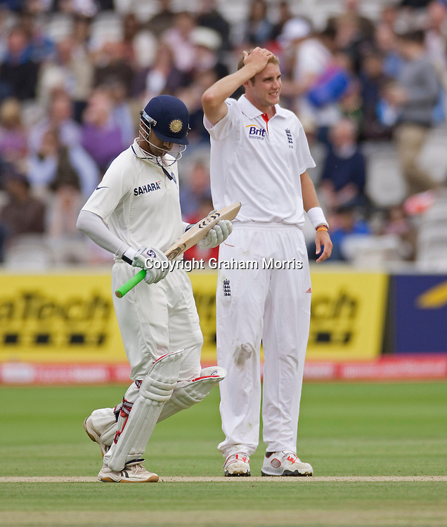 Rahul Dravid runs past bowler Stuart Broad during the first npower Test Match between England and India at Lord's Cricket Ground, London.  Photo: Graham Morris (Tel: +44(0)20 8969 4192 Email: sales@cricketpix.com) 23/07/11