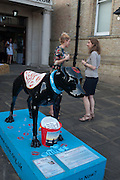 THE BLACK DOG RAISING MONEY FOR 'SANE'  EMMA NORTH; SARA ZMERTYCH, Pop-UP Horsebox Gallery Preview of the Celebration of the Horse in art today  at the Wandsworth Museum,  West Hill. London SW18. 14 August 2012.