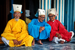 Priests in colorful clothing in the Caodai Great Temple in Tay Ninh.