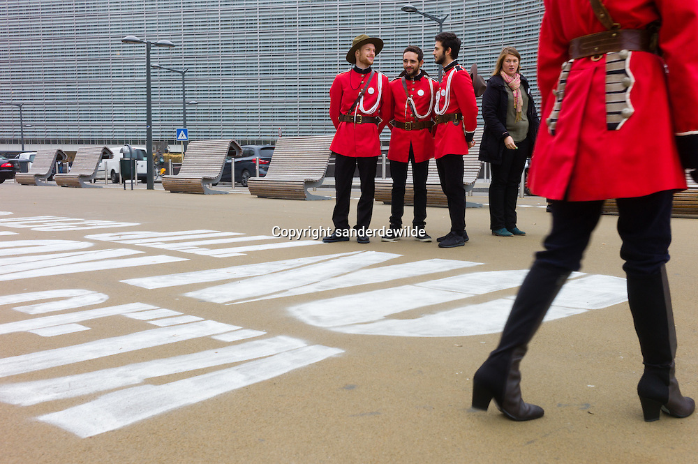 13052016  Brussels Belgium. Pro Ceta activists in Canadian red costumes changed the CETA NO text into CETA NOW in front of European Commission, just when Belgian found an agreement on the CETA and TTIP negotiations.