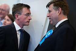 © Licensed to London News Pictures . 04/05/2018. Trafford, UK. Conservative leader of the council SEAN ANSTEE talking to GRAHAM BRADY MP at the Trafford Count in local elections at The Point at Lancashire County Cricket Club . The Labour Party are looking to overturn the Conservative Party's majority on the council . Local council elections are taking place across the country . Photo credit : Joel Goodman/LNP