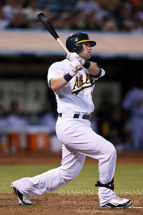 September 24, 2010; Oakland, CA, USA;  Oakland Athletics first baseman Daric Barton (10) at bat against the Texas Rangers during the fourth inning at Oakland-Alameda County Coliseum.  Texas defeated Oakland 10-3.
