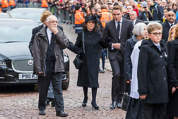 © Licensed to London News Pictures. 31/03/2018. Cambridge, UK. Jane Hawking (C) at the funeral of Stephen Hawking at Church of St Mary the Great in Cambridge, Cambridgeshire. Professor Hawking, who was famous for ground-breaking work on singularities and black hole mechanics, suffered from motor neurone disease from the age of 21. He died at his Cambridge home in the morning of 14 March 2018, at the age of 76. Photo credit: Rob Pinney/LNP