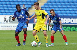 Anthony Grant and Danny Lloyd of Peterborough United close in on James Henry of Oxford United - Mandatory by-line: Joe Dent/JMP - 30/09/2017 - FOOTBALL - ABAX Stadium - Peterborough, England - Peterborough United v Oxford United - Sky Bet League One