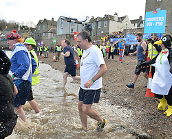 Edinburgh Lord Provost  Donald Wilson was amongst the first Loony Dookers of 2017 as he joined around 1000 other intrepid revellers in the annual event in the Forth on New Years Day.<br /> <br /> &copy; Dave Johnston/ EEm