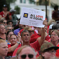 "People gather in Lake Eola park during the ""Marriage Equality Rally"" at the Lake Eola bandshell in downtown Orlando, Florida on Thursday, June 27, 2013. Orlando's gay community and its supporters are celebrating the U.S. Supreme Court rulings on gay marriage and the Defense of Marriage Act (DOMA) reversal that constitutionally denied legally married gay couples federal benefits. (AP Photo/Alex Menendez)"