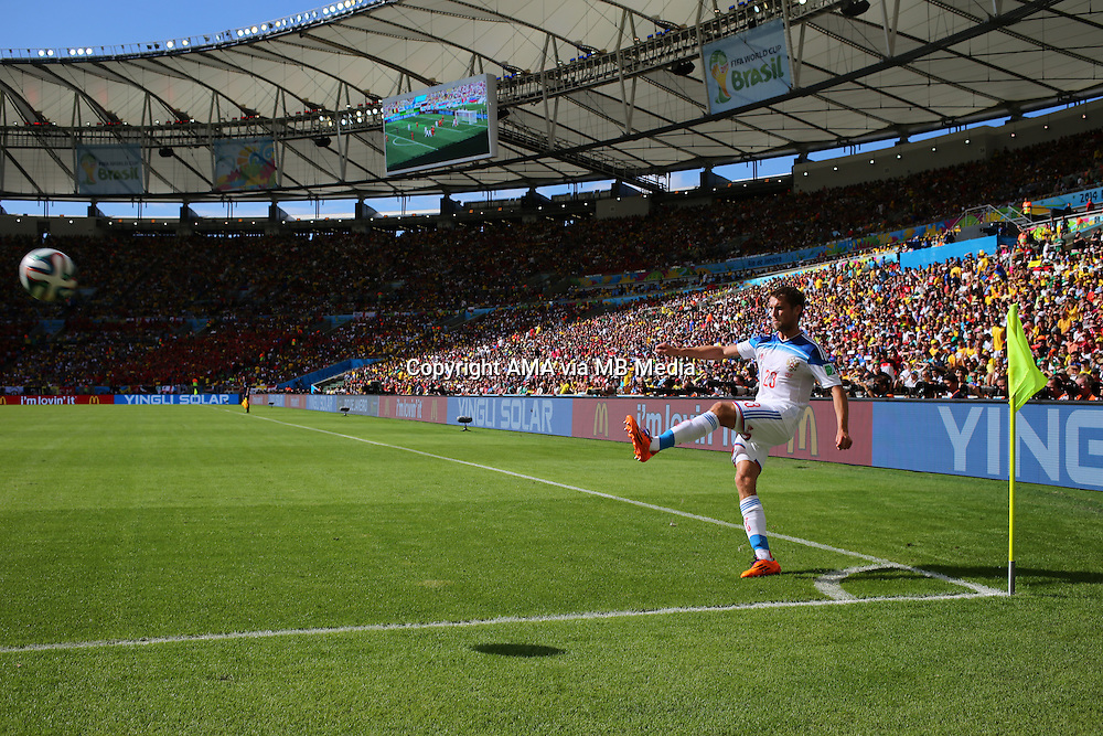 Dmitriy Kombarov of Russia takes a corner in Estadio do Maracana stadium - Estadio Jornalista Mario Filho - ost venue of the FIFA 2014 World Cup