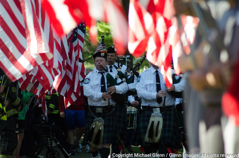 1 Oct 2017 Elmont, New York United States of America // FDNY emerald society pipes and drums march down a flag lined path to kickoff the 3RD annual national stair climb for fallen firefighters at the Belmont Park racetrack  Michael Glenn  /   for the FDNY