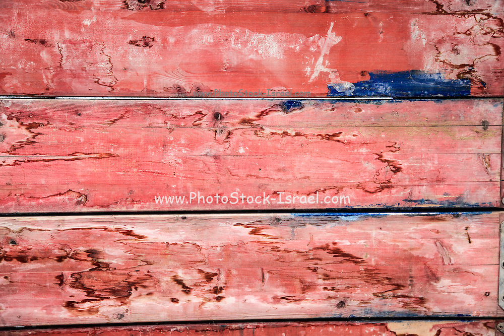 Abstract wood background with faded red paint