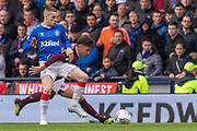 Ryan Kent of Rangers FC getting held back by Aaron Hickey of Hearts during the Betfred Scottish League Cup semi-final match between Rangers and Heart of Midlothian at Hampden Park, Glasgow, United Kingdom on 3 November 2019.