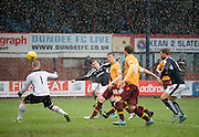 Dundee&rsquo;s Paul McGowan ties past Motherwell&rsquo;s Connor Ripley to make the score 1-1 - Dundee v Motherwell, Ladbrokes Premiership at Dens Park <br /> <br />  - &copy; David Young - www.davidyoungphoto.co.uk - email: davidyoungphoto@gmail.com