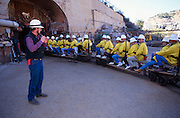 Guide talks to tourists riding train and enjoying Queen Mine tour, Bisbee, Arizona.©1994 Edward McCain.  All rights reserved.  McCain Photography, McCain Creative, Inc.