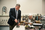 "AUBURN, AL – NOVEMBER 20, 2016: Bart Prorok (left) and Tony Overfelt (right) examine antique cathode ray tubes from television sets for use in an additive manufacturing experiment. In 2016, Auburn University received a grant to develop low cost additive manufacturing techniques, which would allow small businesses interested in additive manufacturing to cheaply test the method's viability for their unique production needs. By repurposing the infrastructure inside cathode ray tubes, the existing electron gun inside the tubes is harnessed for additive manufacturing. ""All the infrastructure used in the million dollar machines is right here in these tubes,"" Prorok said. ""It's more crude, and tuned to a different application, but it's there. We're trying to harness them to do something new."" Prorok believes the method has potential to become the new paradigm for how newer additive manufacturing machines are built.<br /> <br /> In much of the United States, global trade and technological innovation has failed to produce the prosperity hoped for by political and business leaders. Yet despite formidable economic challenges, some localities are flourishing. In Lee County, Ala., unemployment is below the national average despite the loss of thousands of manufacturing jobs, and the key to the county's resilience may be Auburn University, which provided a steady source of employment during recessions and helped draw new businesses to replace those that fled. CREDIT: Bob Miller for The Wall Street Journal<br /> [RESILIENT]"