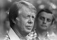 July 1976, Plains, Georgia, USA --- Democratic vice presidential candidate Walter Mondale (right) listens while his running mate, presidential candidate Jimmy Carter, talks to reporters during their campaign for the 1976 presidential election. --- Image by © Owen Franken/Corbis