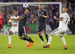 April 21, 2018 - Orlando, FL, U.S. - ORLANDO, FL - APRIL 21: Orlando City defender Yoshimar Yotun (19) heads the ball during the MLS soccer match between the Orlando City FC and the San Jose Earthquakes at Orlando City SC on April 21, 2018 at Orlando City Stadium in Orlando, FL. (Photo by Andrew Bershaw/Icon Sportswire) (Credit Image: © Andrew Bershaw/Icon SMI via ZUMA Press)