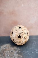 Woven ball of organic fibers on time worn surfaces.