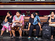 02 JANUARY 2019 - BANGKOK, THAILAND:      People wait to get their train in Hua Lamphong Train Station in Bangkok. The train and bus stations in Bangkok were crowded Wednesday with people going home after the long New Year's weekend.     PHOTO BY JACK KURTZ
