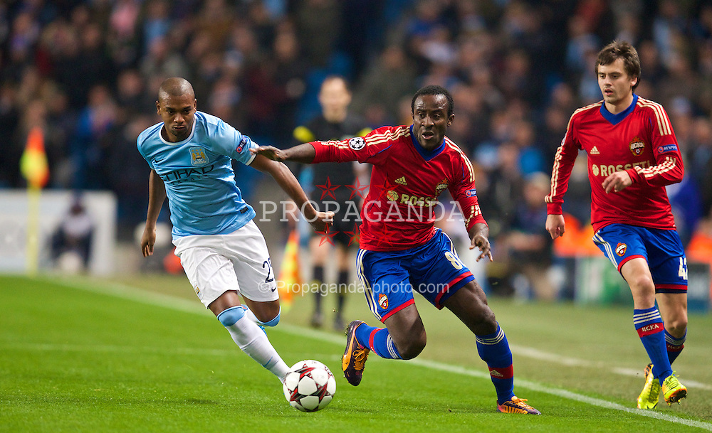 MANCHESTER, ENGLAND - Tuesday, November 5, 2013: Manchester City's Fernando Luiz Roza 'Fernandinho' in action against CSKA Moscow's Seydou Doumbia during the UEFA Champions League Group D match at the City of Manchester Stadium. (Pic by David Rawcliffe/Propaganda)