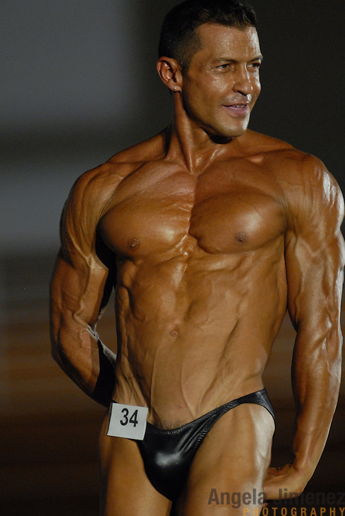 Luis Henriquez, of Caracas, Venezuela, poses during the Physique (bodybuilding) competition 40-49 year old age group lightweight division at McGaw Memorial Hall/Welsh-Ryan Arena at Northwestern University in Evanston, Illinois during the Gay Games VII competition on July 19, 2006. <br /> <br /> <br /> Henriquez finished fifth in the modified category in his division. <br /> <br /> Over 12,000 gay and lesbian athletes from 60 countries are in Chicago competing in 30 sports during the Games from July 15 through 22, 2006. <br /> <br /> Over 50,000 athletes have competed in the quadrennial Games since they were founded by Dr. Tom Wadell, a 1968 Olympic decathlete, and a group of friends in San Francisco in 1982, with the goal of using athletics to promote community building and social change. <br /> <br /> The Gay Games resemble the Olympics in structure, but the spirit is one of inclusion, rather than exclusivity. There are no qualifying events or minimum or maximum requirements.<br /> <br /> The Games have been held in Vancouver (1990), New York (1994), Amsterdam (1998), and Sydney (2002).