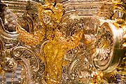 Close up of elaborately metalwork in gold inside the Catholic cathedral, former great mosque,  Cordoba, Spain
