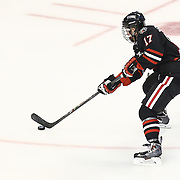 Torin Snyderman #17 of the Northeastern Huskies controls the puck during The Beanpot Championship Game at TD Garden on February 10, 2014 in Boston, Massachusetts. (Photo by Elan Kawesch)