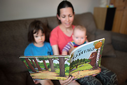 A mother and children read a copy of 'The Gruffalo', at home in London.  Picture date: Sunday May 10, 2020. Photo credit should read: Matt Crossick/Empics