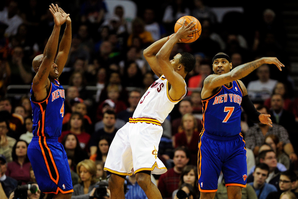 Feb. 25, 2011; Cleveland, OH, USA; New York Knicks point guard Chauncey Billups (4) and New York Knicks small forward Carmelo Anthony (7) try to stop Cleveland Cavaliers point guard Ramon Sessions (3) during the first quarter at Quicken Loans Arena. Mandatory Credit: Jason Miller-US PRESSWIRE