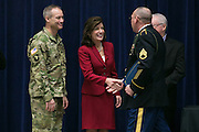 New York State Lieutenant Governor Kathy Hochul shakes hands with a graduate at the graduation ceremony for Solar Ready Veterans at Fort Drum on Wednesday, February 17, 2016.