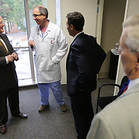 Dr. Ed Hill, left, talks with Dr. J. Murray Estess at the North Mississippi Medical Center, during Hill's retirement reception Friday afternoon for his 22 years of service.