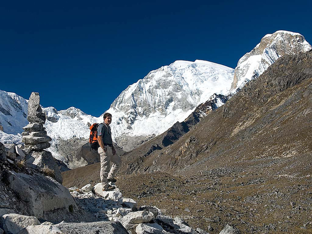 James Voortman below the summits of Chopicalqui 6,354m (left), Huascarán Sur (South) 6,768m (centre) and Huascarán Norte (North) 6,664m (right).  Viewed from the trail between Pisco Base Camp and Laguna 69, at approx. 4,900m.