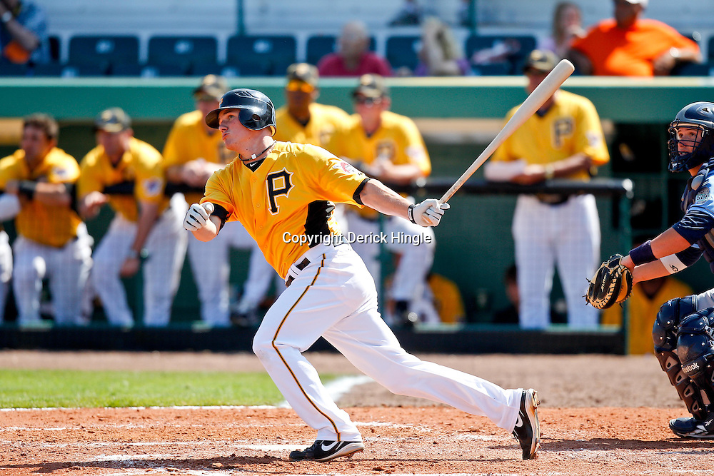 February 25, 2011; Bradenton, FL, USA; Pittsburgh Pirates first baseman Garrett Atkins (10) watches after hitting a homerun during a spring training exhibition game against the State College of Florida Manatees at McKechnie Field. The Pirates defeated the Manatees 21-1. Mandatory Credit: Derick E. Hingle