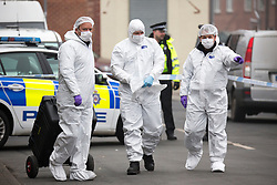 © Licensed to London News Pictures. 27/01/2017. Leeds UK. Picture shows Police forensic officers on the scene where a man has been shot & seriously injured at a barbers shop on Gathorne Terrace in the Chapeltown area of Leeds. Photo credit: Andrew McCaren/LNP