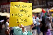 Frankfurt am Main | 26 July 2014<br /> <br /> Am Samstag (26.07.2014) demonstrierten etwa 500 Menschen auf dem R&ouml;merberg in Frankfurt am Main f&uuml;r Frieden in Pal&auml;stina / Gaza und f&uuml;r ein sofortiges Ende der israelischen Milit&auml;reins&auml;tze dort.<br /> Hier: Eine junge Frau h&auml;lt ein Plakat mit der Aufschrift &quot;Lasst Euch nicht betr&uuml;gen - deutsche Medien l&uuml;gen&quot;.<br /> <br /> &copy;peter-juelich.com<br /> <br /> FOTO HONORARPFLICHTIG!<br /> <br /> [No Model Release | No Property Release]
