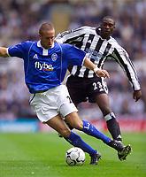 Photo. Jed Wee<br /> Newcastle United v Birmingham City, FA Barclaycard Premiership, St. James' Park, Newcastle. 30/08/2003.<br /> Birmingham's Matthew Upson (L) looks to turn away from Newcastle's Shola Ameobi.