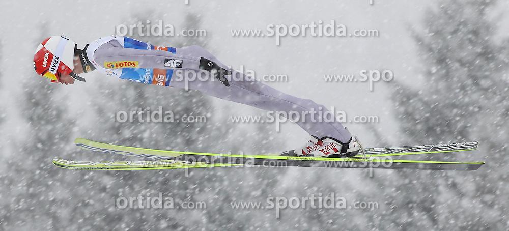 31.12.2011, Olympia Skisprungschanze, Garmisch Partenkirchen, GER, 60. Vierschanzentournee, FIS Ski Sprung Weltcup, Training, im Bild Kamil STOCH (POL) // Kamil STOCH (POL) during a practice session of 60th Four-Hills-Tournament FIS World Cup Ski Jumping at Olympia Skisprungschanze, Garmisch Partenkirchen, Germany on 2011/12/31. EXPA Pictures © 2011, PhotoCredit: EXPA/ Sven Kiesewetter