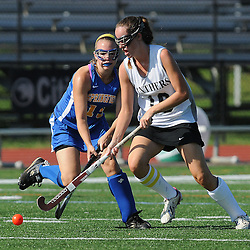 Strath Haven's Katie Sherry (16) and Springfield's Chrissy Dexter (13) fight for possession of the ball during the Springfield at Strath Haven girls field hockey game in Nether Providence on Thursday, September 4, 2014.  (Times staff / TOM KELLY IV)