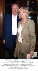 LORD & LADY HESKETH at a party in London on 10th June 2003.PKH 207