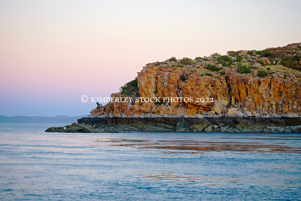 Soft early morning light highlights a tideline in the Sale River on the Kimberley coast.