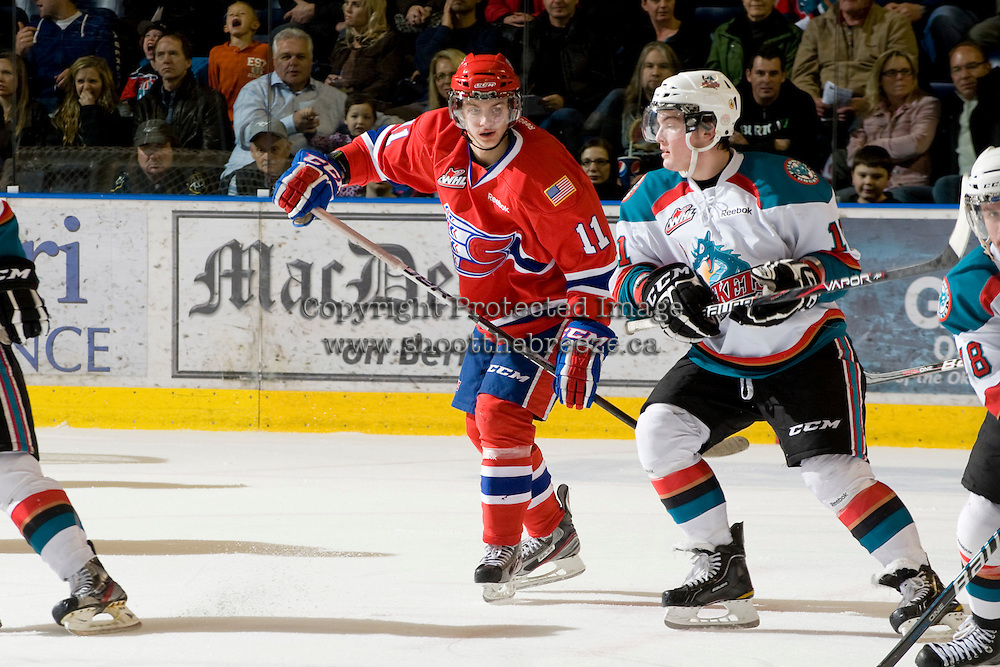KELOWNA, CANADA, JANUARY 4: Liam Stewart #11 of the Spokane Chiefs skates on the ice as the Spokane Chiefs visit the Kelowna Rockets on January 4, 2012 at Prospera Place in Kelowna, British Columbia, Canada. Stewart is the son of Sports Illustrated swimwear model Rachel Hunter and rock musician Rod Stewart. (Photo by Marissa Baecker/Getty Images) *** Local Caption ***