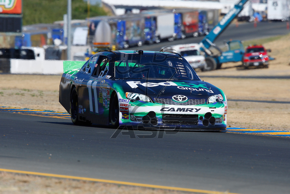 SONOMA, CA - JUN 23, 2012:  Denny Hamlin (11) brings his car through turn 10 during a practice session for the Toyota Save Mart 350 at the Raceway at Sonoma in Sonoma, CA.