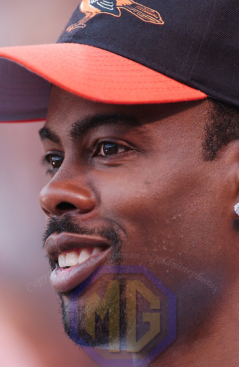 8-24-02:  Chris Rock takes the field at Orioles Park at Camden Yards in Baltimore, Maryland to film scenes from his upcoming movie Head of State, where he plays Residential Candidate Mays Gilliam.