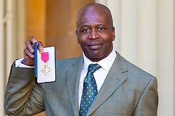 Detective Sergeant Isaac Idun proudly displays his OBE for services to policing following an investiture ceremony at Buckingham Palace in London. London, March 14 2019.