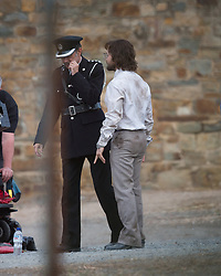 "EXCLUSIVE: Daniel Radcliffe was looking worse for wear as he got into character for filming of ""Escape from Pretoria"" in Adelaide. Daniel was looking scruffy as he wore a very dirty business shirt tucked into his pants with a tie and grey pants with a pair of eye glasses. His co-star had a bloodied face. The filming took place at the old Adelaide Gaol which has been transformed into Pretoria prison for filming. Daniel and his co-star in the scene were shackled as they exited a white van and were met by many officers. Daniel's character had his legs shackled as well as his hands in parts of the scene. It's a far different look from the boy who was once Harry Potter. Filming will continue over the next few weeks in Adelaide. 11 Mar 2019 Pictured: Daniel Radcliffe. Photo credit: MEGA TheMegaAgency.com +1 888 505 6342"