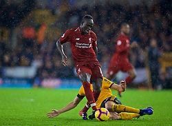 WOLVERHAMPTON, ENGLAND - Friday, December 21, 2018: Liverpool's Sadio Mane is tackled by Wolverhampton Wanderers' Morgan Gibbs-White during the FA Premier League match between Wolverhampton Wanderers FC and Liverpool FC at Molineux Stadium. (Pic by David Rawcliffe/Propaganda)