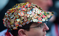BIRMINGHAM, ENGLAND - Sunday, April 4, 2010: A Liverpool supporter wearing badges on his cap during the Premiership match against Birmingham City at St Andrews. (Photo by David Rawcliffe/Propaganda)