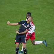 Nov 8, 2015; Harrison, NJ, USA; D.C. United forward Alvaro Saboru (9) heads the ball during the second half of the MLS Playoffs at Red Bull Arena. Mandatory Credit: William Hauser-USA TODAY Sports